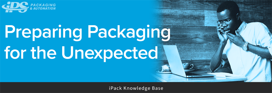 man looking surprised at computer with white text on left reading preparing packaging for the unexpected