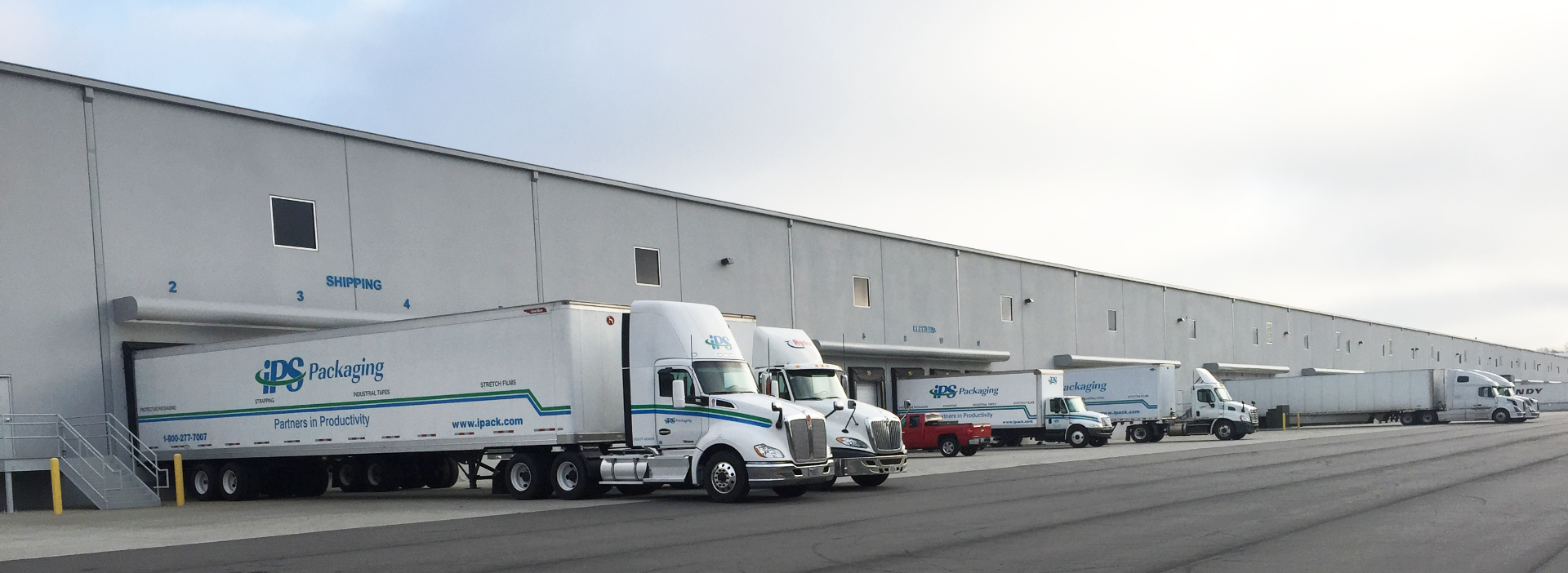 ips packaging & automation semi trucks backed into loading dock at warehouse