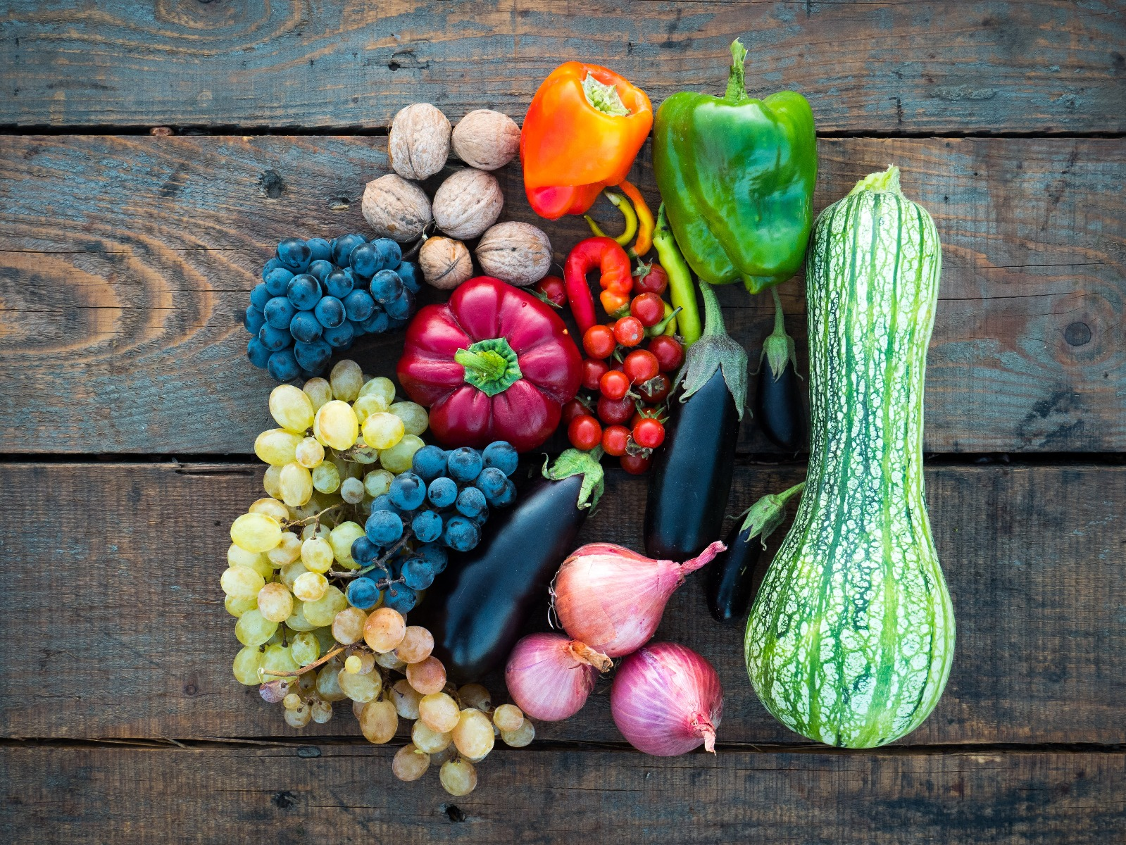 assorted fruits and vegetables on wood table