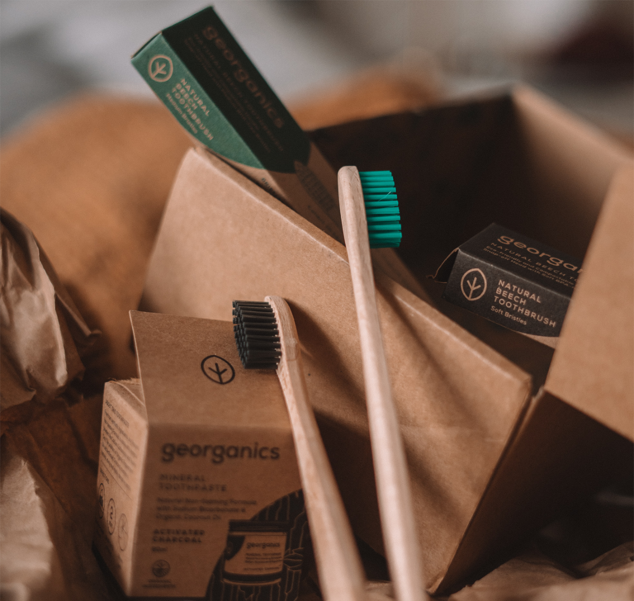 wooden toothbrushes packaged in small recyclable corrugated boxes