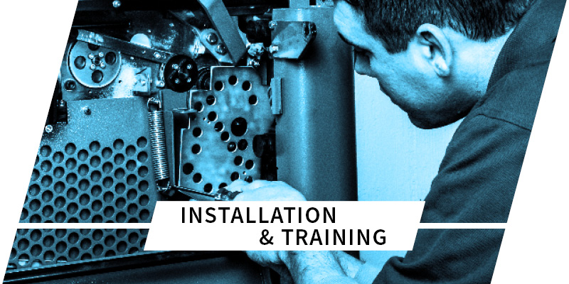 man fixing gears on packaging equipment with text saying installation and training on top
